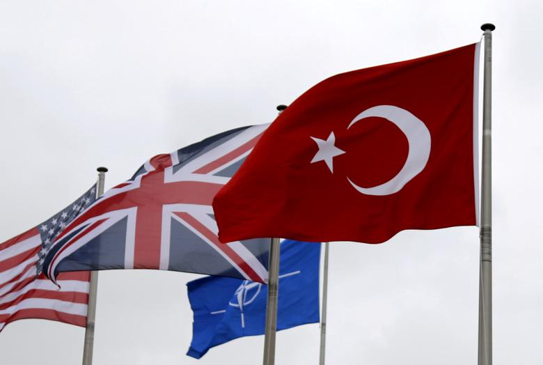 FILE PHOTO: A Turkish flag (R) flies among others flags of NATO members during the North Atlantic Council (NAC) at the Alliance headquarters in Brussels, Belgium, July 28, 2015. REUTERS/Francois Lenoir/File Photo