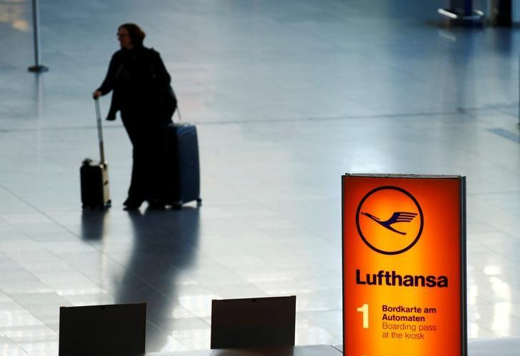 A passenger walks through a terminal during a pilots strike of the German airline Lufthansa at Frankfurt airport, Germany November 29, 2016. REUTERS/Ralph Orlowski/Files