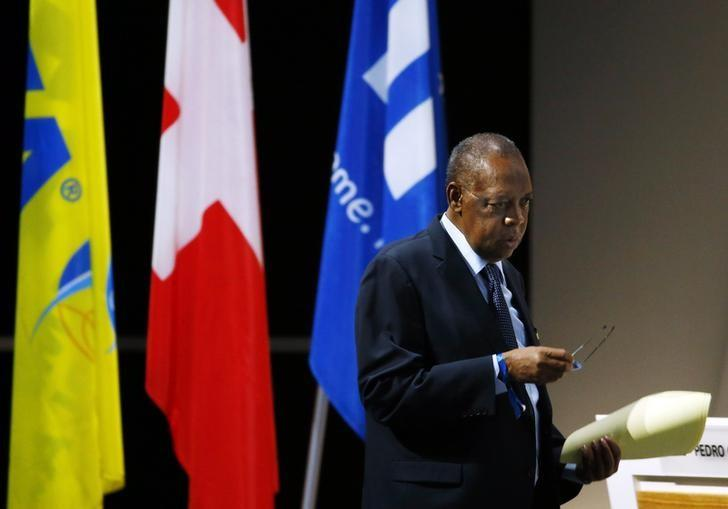 File Photo - Acting FIFA president Issa Hayatou walks back to his seat after an address during the Extraordinary FIFA Congress in Zurich, Switzerland February 26, 2016. REUTERS/Ruben Sprich