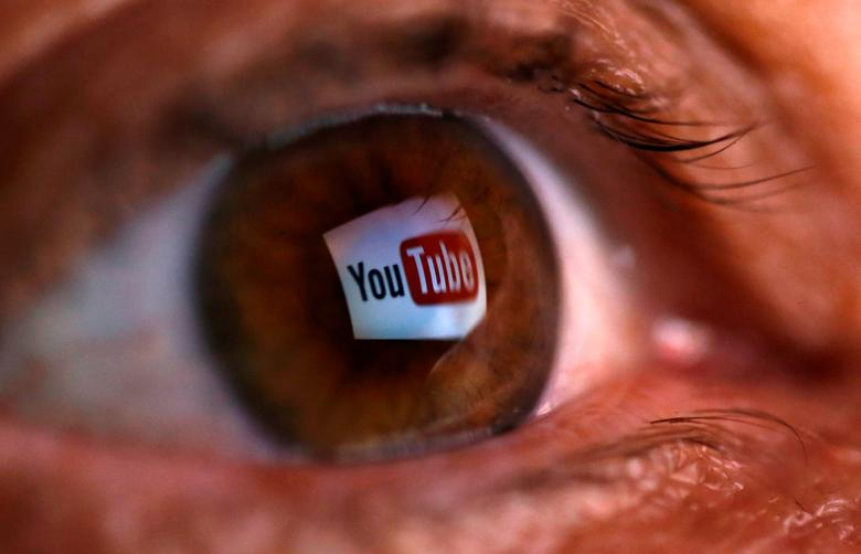 FILE PHOTO: A picture illustration shows a YouTube logo reflected in a person's eye June 18, 2014.  REUTERS/Dado Ruvic/File Photo