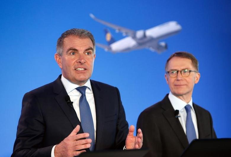 German airline Lufthansa CEO Carsten Spohr and CFO Ulrik Svensson (R) arrive for the company's annual news conference in Munich, Germany, March 16, 2017. REUTERS/Michaela Rehle