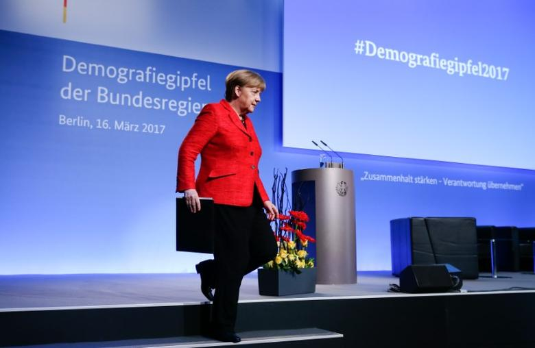 German Chancellor Angela Merkel leaves the stage after her speech at the demographic summit in Berlin, Germany, March 16, 2017.     REUTERS/Fabrizio Bensch