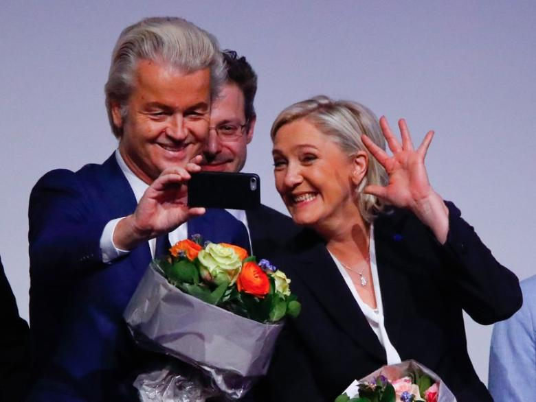 France's National Front leader Marine Le Pen and Netherlands' Party for Freedom (PVV) leader Geert Wilders take a Selfie during a European far-right leaders meeting to discuss about the European Union, in Koblenz, Germany, January 21, 2017.     REUTERS/Wolfgang Rattay