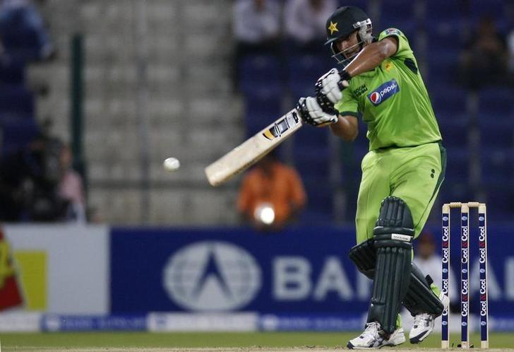 FILE PHOTO - Pakistan's Shahzaib Hasan plays a shot during their first Twenty20 international cricket match against South Africa in Abu Dhabi October 26, 2010. REUTERS/Nikhil Monteiro