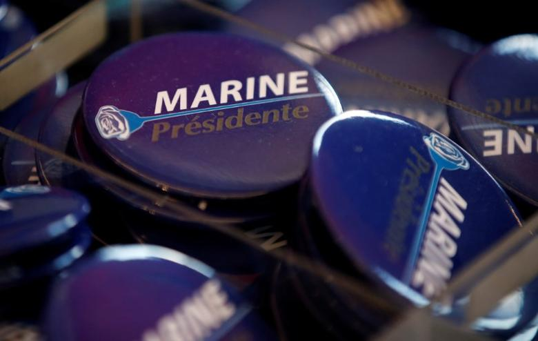 Badges for Marine Le Pen, French National Front (FN) political party leader and candidate for French 2017 presidential election, are displayed to sell before a political rally in Saint-Raphael, France, March 15, 2017.  REUTERS/Jean-Paul Pelissier