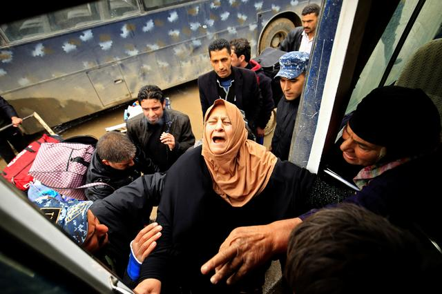 A displaced Iraqi woman, who fled from clashes, reacts as she is transferred to a safe area during a battle between Iraqi forces and Islamic State militants, in Mosul, Iraq March 17, 2017. REUTERS/Thaier Al-Sudani