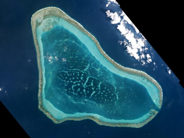 Boats at Scarborough Shoal in the South China Sea are shown in this handout photo provided by Planet Labs, and captured on March 12, 2016. REUTERS/Planet Labs/Handout via Reuters