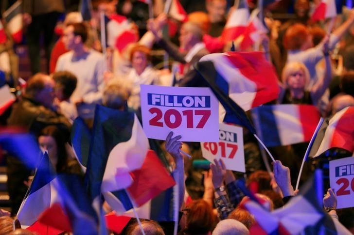 A supporter holds a board during former French Prime Minister, member of the Republicans political party and 2017 presidential election candidate of the French centre-right Francois Fillon's campaign rally in Caen, France March 16, 2017. REUTERS/Philippe Wojazer