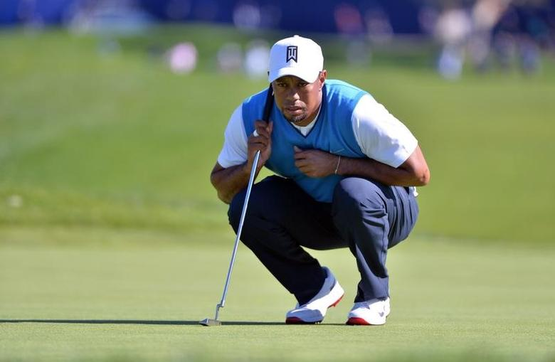 Jan 26, 2017; La Jolla, CA, USA; Tiger Woods lines up a putt on the 1st green during the first round of the Farmers Insurance Open golf tournament at Torrey Pines Municipal Golf Course. Mandatory Credit: Orlando Ramirez-USA TODAY Sports