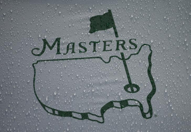 Rain falls onto the logo on a Masters unbrella during a players practice round ahead of the 2015 Masters at Augusta National Golf Course in Augusta, Georgia April 7, 2015.  REUTERS/Phil Noble/File Photo