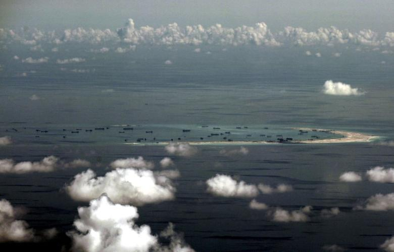 FILE PHOTO -  An aerial photo taken though a glass window of a Philippine military plane shows the alleged on-going land reclamation by China on mischief reef in the Spratly Islands in the South China Sea, west of Palawan, Philippines, in this file photo dated May 11, 2015.  REUTERS/Ritchie B. Tongo/Pool/File Photo