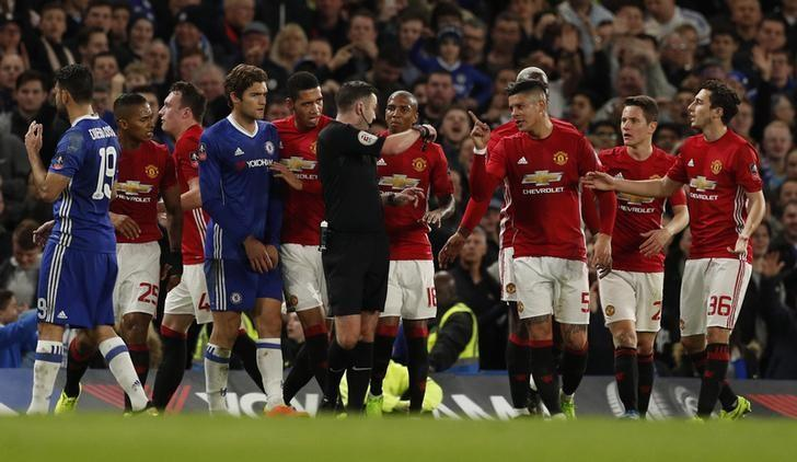 Britain Football Soccer - Chelsea v Manchester United - FA Cup Quarter Final - Stamford Bridge - 13/3/17 Manchester United's Marcos Rojo and teammates remonstrate with referee Michael Oliver after Ander Herrera was shown a red card Action Images via Reuters / John Sibley Livepic