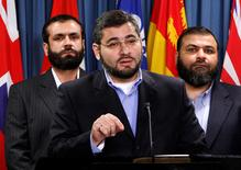 FILE PHOTO --  Abdullah Almalki (C), with Muayyed Nureddin (L) and Ahmad El Maati, speaks during a news conference on Parliament Hill in Ottawa October 12, 2007.     REUTERS/Chris Wattie/File Photo