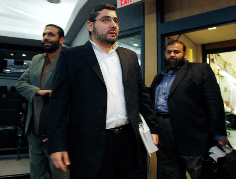 FILE PHOTO --  Muayyed Nureddin (L) arrives for the start of a news conference with Abdullah Almalki (C) and Ahmad El Maati in Ottawa October 21, 2008. Canadian security services probably contributed indirectly to the torture in Syria of the three Arab Canadians who had been suspected of involvement in terrorist activities, an official inquiry found on Tuesday.       REUTERS/Chris Wattie/File Photo