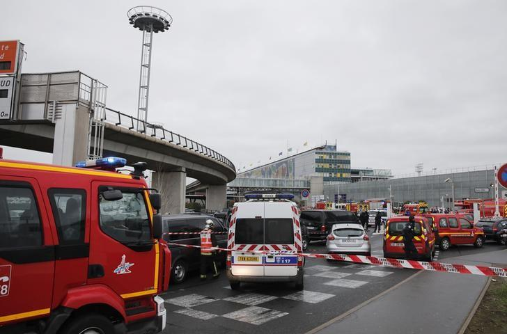 General view of emergency vehicles at Orly airport southern terminal after a shooting incident near Paris, France March 18, 2016.  REUTERS/Benoit Tessier