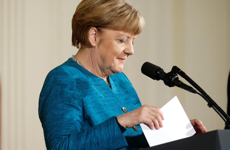 German Chancellor Angela Merkel sorts her notes during a joint news conference with U.S. President Donald Trump in the East Room of the White House in Washington, U.S., March 17, 2017. REUTERS/Joshua Roberts