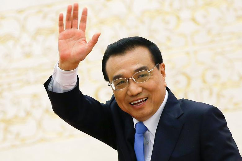 China's Premier Li Keqiang waves as he leaves the room after a news conference following the closing ceremony of China's National People's Congress (NPC) at the Great Hall of the People in Beijing, China, March 15, 2017. REUTERS/Damir Sagolj
