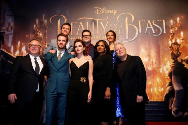 Director of the movie Bill Condon and composer Alan Menken pose with cast members Dan Stevens, Luke Evans, Emma Watson, Josh Gad, Audra McDonald and Gugu Mbatha-Raw at the premiere of ''Beauty and the Beast'' in Los Angeles, California, U.S. March 2, 2017. REUTERS/Mario Anzuoni