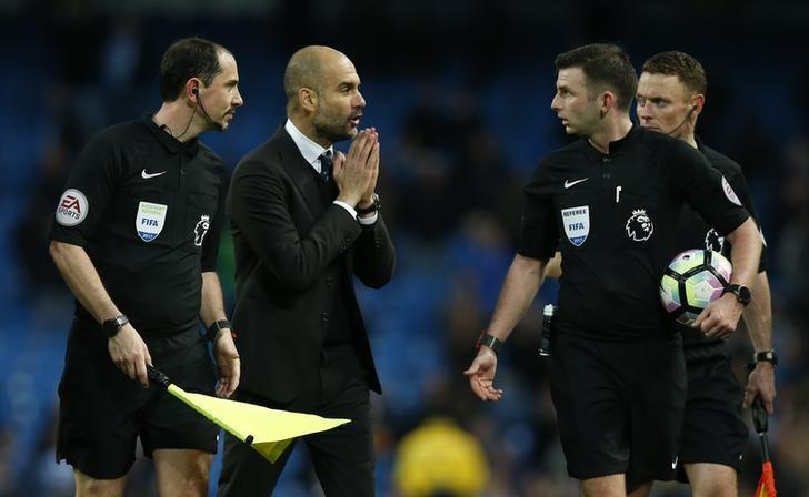 Britain Soccer Football - Manchester City v Liverpool - Premier League - Etihad Stadium - 19/3/17 Manchester City manager Pep Guardiola speaks with referee Michael Oliver after the game Reuters / Andrew Yates Livepic