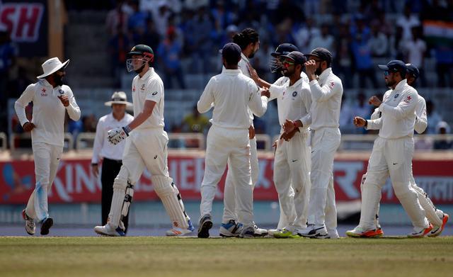 Cricket - India v Australia - Third Test cricket match - Jharkhand State Cricket Association Stadium, Ranchi, India - 20/03/17 - Australia's Matt Renshaw (2nd L) walks off the field as Indian players celebrate his dismissal. REUTERS/Adnan Abidi