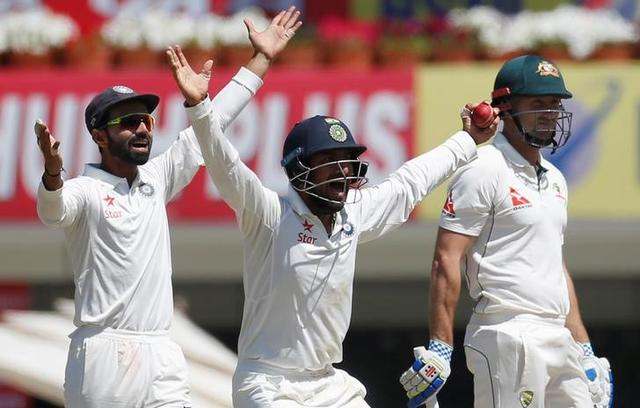 Cricket - India v Australia - Third Test cricket match - Jharkhand State Cricket Association Stadium, Ranchi, India - 16/03/17 - India's Ajinkya Rahane (L) and Cheteshwar Pujara (C) successfully appeals for the dismissal of Australia's Shaun Marsh. REUTERS/Adnan Abidi