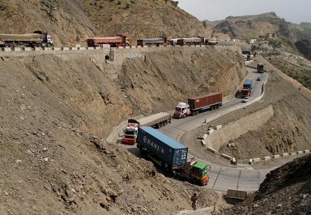 Trucks, stuck for days in Pakistan due to border conflict, travel toward the border post at Torkham, Pakistan June 18, 2016. REUTERS/Fayaz Aziz/Files