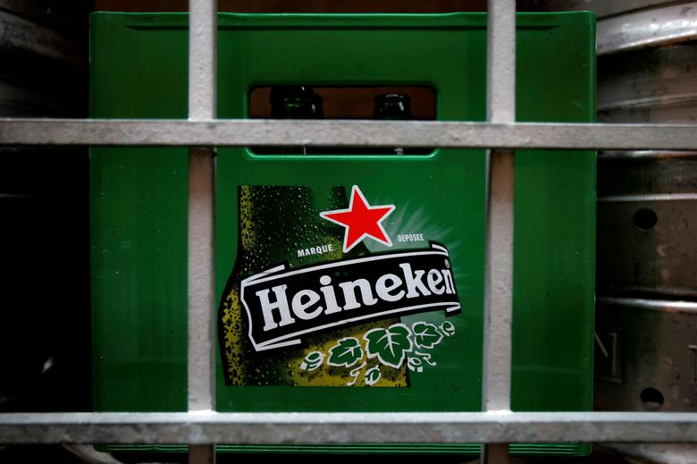 FILE PHOTO: A plastic container with empty bottles of Heineken beers are pictured among beer kegs outside a restaurant in Singapore August 29, 2012.   REUTERS/Tim Chong/File Photo