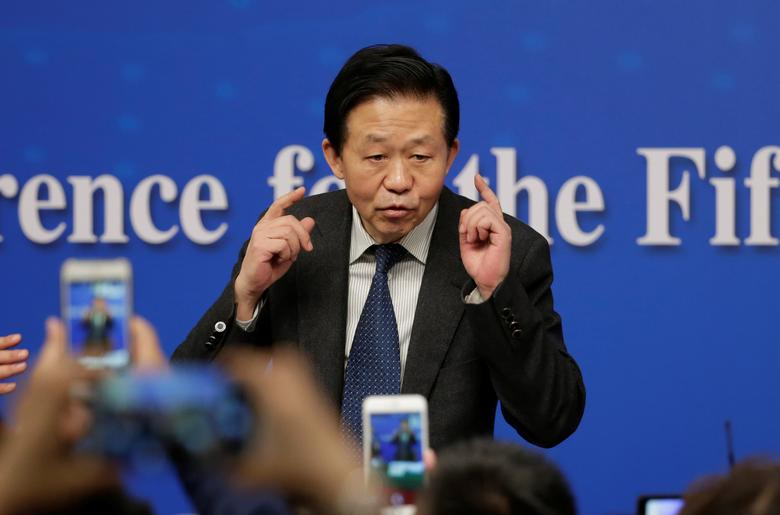 FILE PHOTO - Chinese Finance Minister Xiao Jie speaks to the media after his news conference during the ongoing National People's Congress (NPC), China's parliament, in Beijing China March 7, 2017. REUTERS/Jason Lee