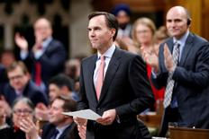 FILE PHOTO --  Canada's Finance Minister Bill Morneau receives a standing ovation while announcing the date of the federal budget during Question Period in the House of Commons on Parliament Hill in Ottawa, Ontario, Canada, March 7, 2017. REUTERS/Chris Wattie/File Photo