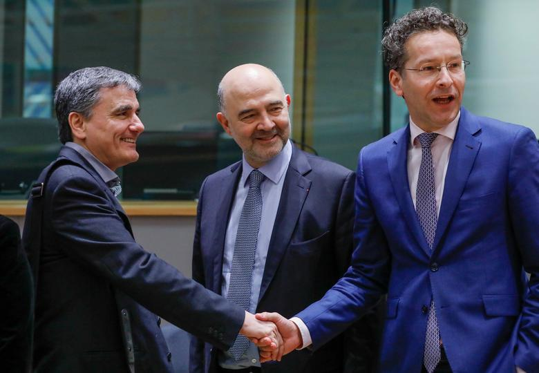 Greek Finance Minister Euclid Tsakalotos (L), European Economic and Financial Affairs Commissioner Pierre Moscovici (C) and Dutch Finance Minister and Eurogroup President Jeroen Dijsselbloem take part in a eurozone finance ministers meeting in Brussels, Belgium March 20, 2017. REUTERS/Yves Herman
