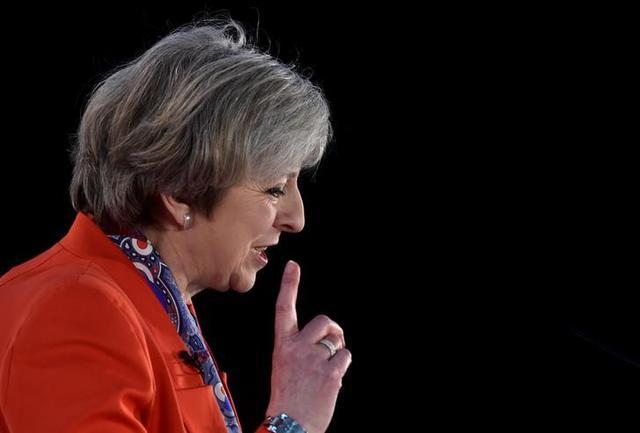 3月20日、メイ英首相は来週29日、EU基本条約50条を発動し、EUに対して正式な離脱通告を行う。写真は今月17日撮影。(2017年 ロイター/Rebecca Naden)