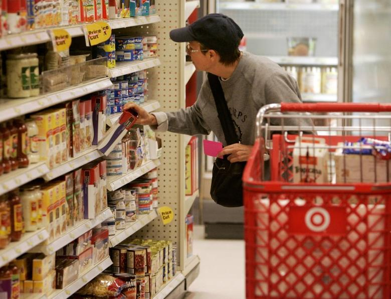 A shopper looks at grocery items at a Target store in Los Angeles, California August 18, 2009. REUTERS/Fred Prouser