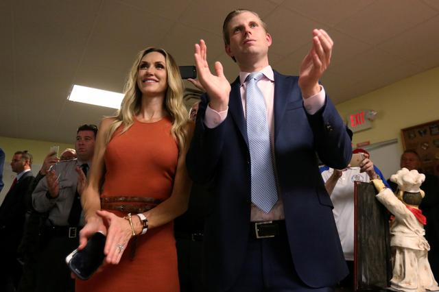 FILE PHOTO: Eric Trump, son of Republican presidential candidate Donald Trump, and his wife Lara Yunaska during a campaign event in Statesville, North Carolina, U.S., August 18, 2016. REUTERS/Carlo Allegri/File Photo