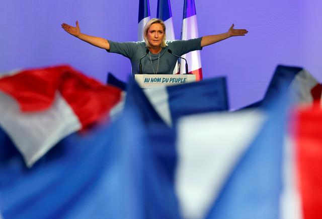 FILE PHOTO: Marine Le Pen, French National Front (FN) political party leader, gestures during an FN political rally in Frejus, France, September 18, 2016.     REUTERS/Jean-Paul Pelissier/File Photo