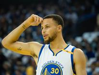 Mar 16, 2017; Oakland, CA, USA; Golden State Warriors guard Stephen Curry (30) reacts after a foul call against the Golden State Warriors during the first quarter against the Orlando Magic at Oracle Arena. Mandatory Credit: Kelley L Cox-USA TODAY Sports