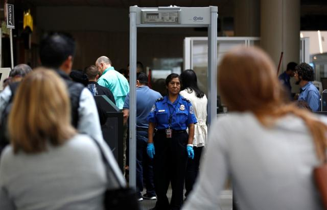 Travelers stand in line to go through Transportation Security Administration (TSA) check-points at Los Angeles International Airport in Los Angeles, U.S., May 31, 2016.   REUTERS/Mario Anzuoni