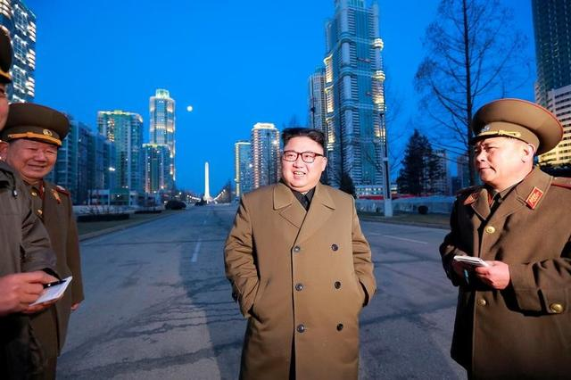 FILE PHOTO: North Korean leader Kim Jong Un provides field guidance at the construction site of Ryomyong Street in this undated picture provided by KCNA in Pyongyang on March 16, 2017. KCNA/via Reuters