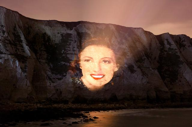 A projection wishing singer and war time sweetheart Vera Lynn a happy birthday is projected on to the cliffs at Dover, Britain, March 17, 2017. Picture take March 17, 2017 Decca Records handout via REUTERS