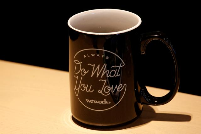 FILE PHOTO -  A mug bears the name of WeWork is seen at its flagship location in Hong Kong, China February 23, 2017.      REUTERS/Bobby Yip/File Photo