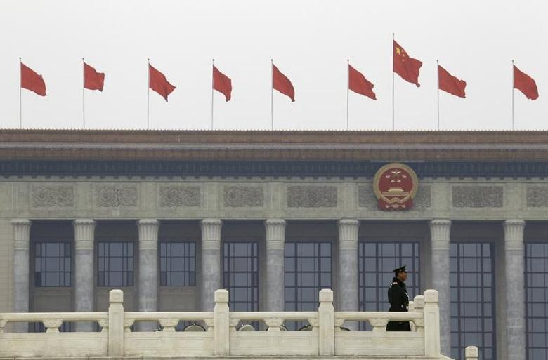 A paramilitary policeman stands guard in front of the Great Hall of the People on Tiananmen Square ahead of the fourth plenary meeting of China's parliament, the National People's Congress (NPC), in Beijing March 11, 2010.      REUTERS/David Gray