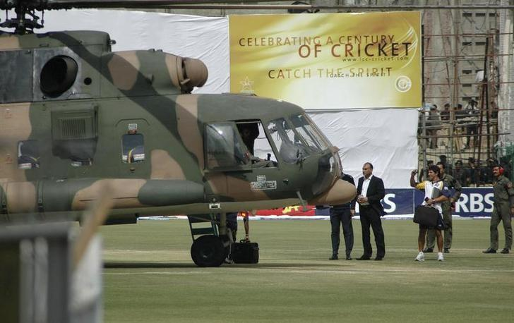 Sri Lanka's cricket team members prepare to board a Pakistani military helicopter at the Gaddafi stadium after their team bus was attacked by gunmen while on the way to the stadium in Lahore March 3, 2009. REUTERS/Syed Mujtaba/Files