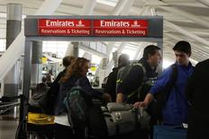 Travelers walk past an Emirates Airlines ticket desk at JFK International Airport in New York, U.S., March 21, 2017.  REUTERS/Lucas Jackson