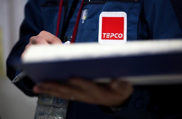 FILE PHOTO: A Tokyo Electric Power Co. (TEPCO) logo is seen on a uniform of an employee at the company's Fukushima Daiichi nuclear power plant in Okuma, Fukushima, Japan, February 23, 2017.  REUTERS/Tomohiro Ohsumi/Pool