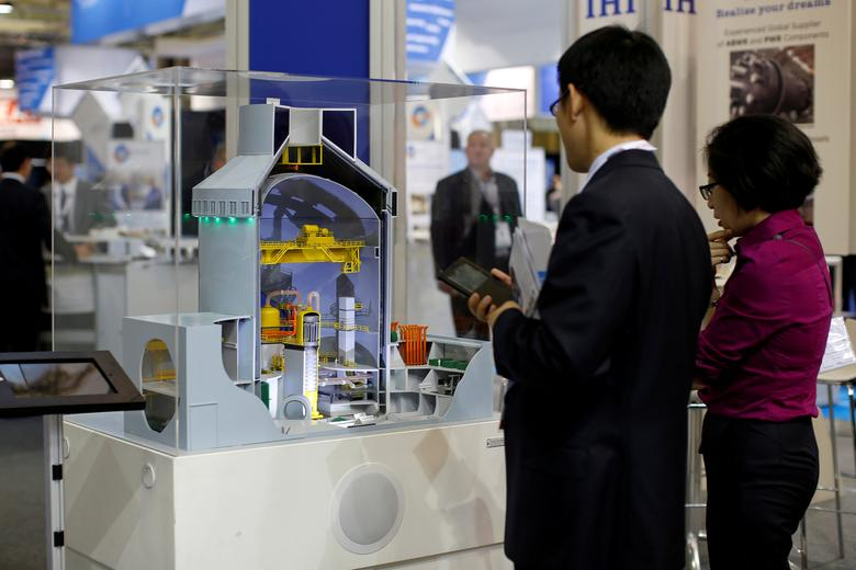 FILE PHOTO - Visitors look at a nuclear power plant station model by American company Westinghouse at the World Nuclear Exhibition 2014, the trade fair event for the global nuclear energy sector, in Le Bourget, near Paris October 14, 2014. REUTERS/Benoit Tessier/File Photo