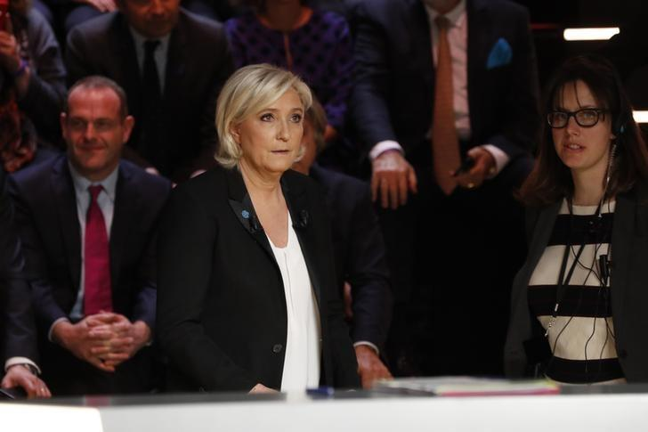 Candidate for the 2017 presidential election Marine Le Pen, French National Front (FN) political party leader, arrives for a debate organised by French private TV channel TF1 in Aubervilliers, outside Paris, France, March 20, 2017. REUTERS/Patrick Kovarik/Pool
