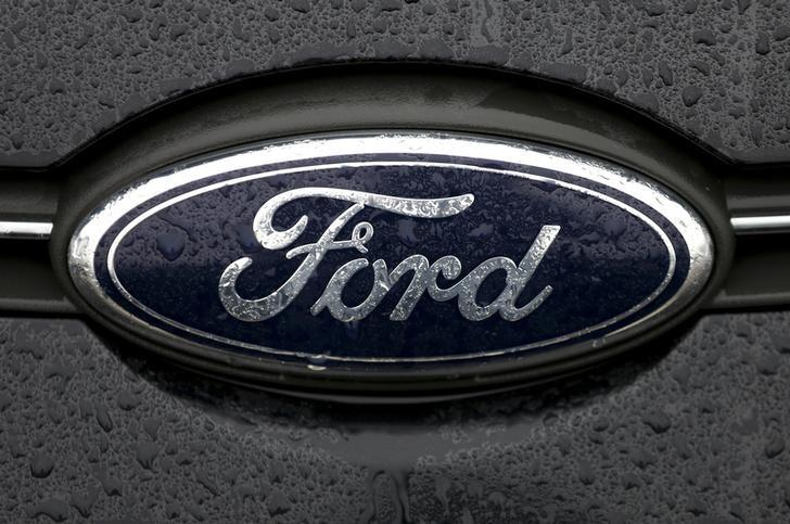 The Ford logo is pictured at the Ford Motor Co plant in Genk December 17, 2014. In 2012 Ford announced that production of the models made in Genk would move to Valencia, Spain, with the loss of 4,300 jobs at the Belgian site.    REUTERS/Francois Lenoir/Files