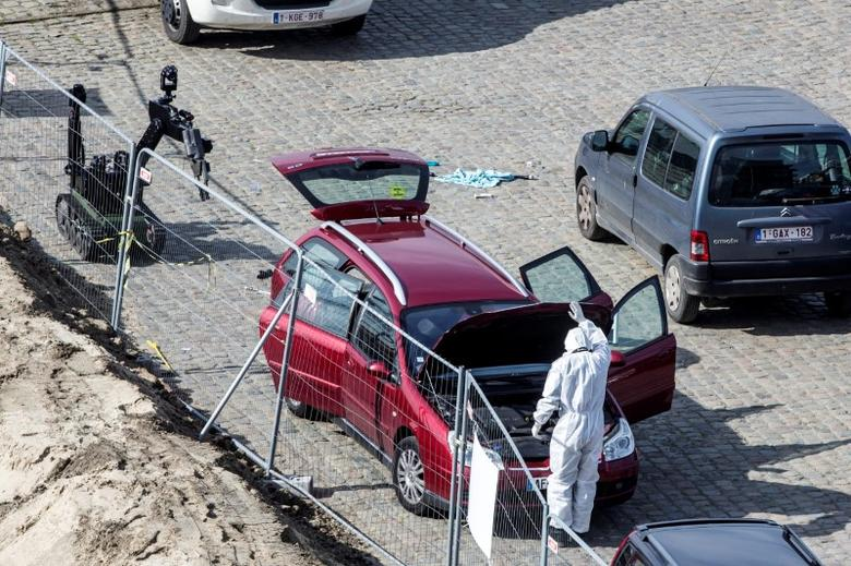 A forensics expert stands next to a car which had entered the main pedestrian shopping street in the city at high speed, in Antwerp, Belgium, March 23, 2017. REUTERS/Joris Herregods