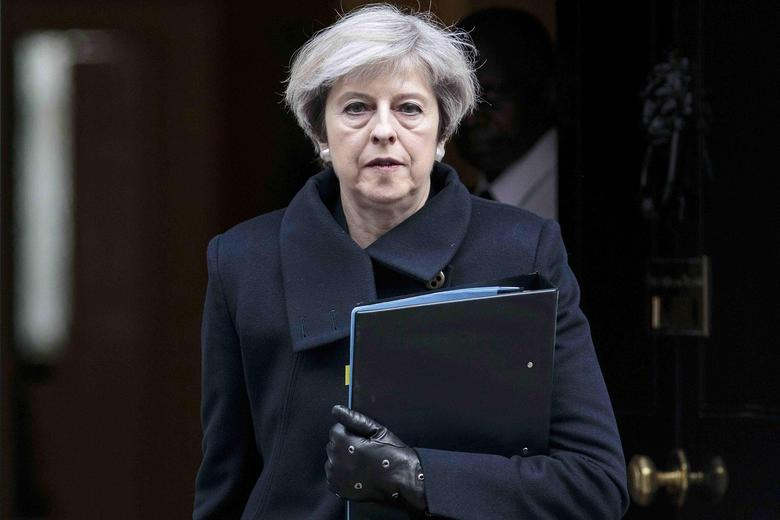 Britain's Prime Minister Theresa May leaves 10 Downing Street the morning after an attack by a man driving a car and weilding a knife left five people dead and dozens injured, in London, Britain, March 23, 2017. REUTERS/Jack Taylor/Pool