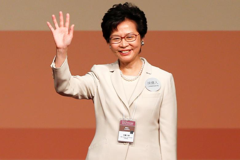 Carrie Lam waves after she won the election for Hong Kong's Chief Executive in Hong Kong, China March 26, 2017.   REUTERS/Bobby Yip