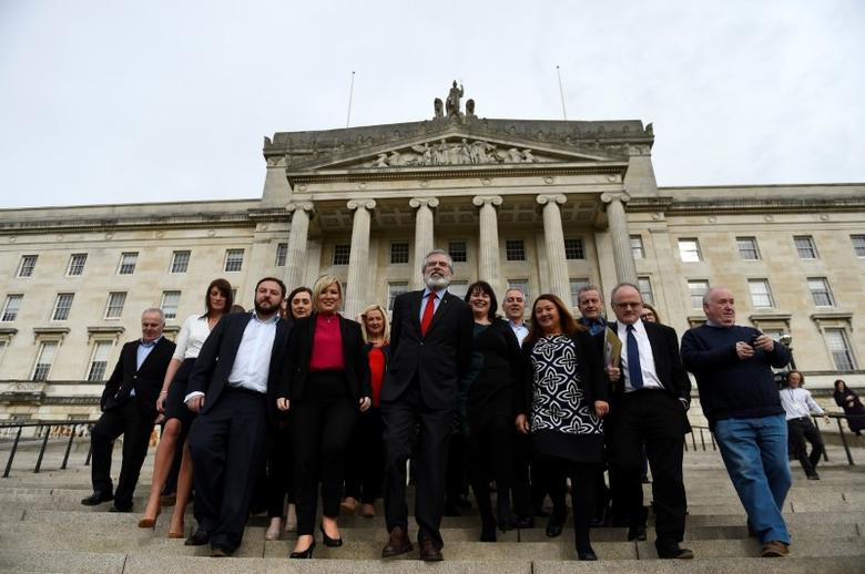 Sinn Fein President Gerry Adams gestures as he and Sinn Fein leader Michelle O'Neill introduce the new Sinn Fein Assembly team at Parliament buildings in Belfast, Northern Ireland March 6, 2017. REUTERS/Clodagh Kilcoyne